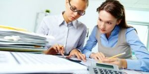 14726879 - portrait of two businesswomen working with papers in office